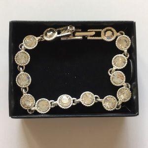 Avon silvertone tennis bracelet